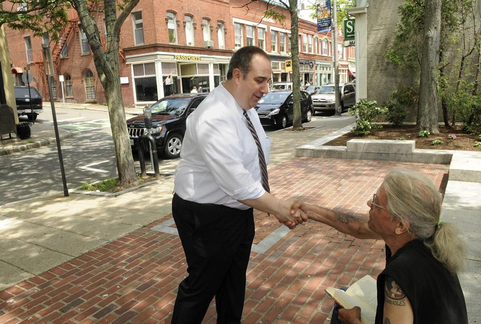 Gloucester Police Chief Leonard Campanello greeted Adelard Charron, a former addict who is now in recovery, on Main Street last month.